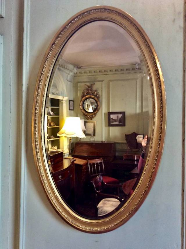 19th century large oval gilt mirror