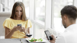 Putting your phone away while eating with someone is basic etiquette (Image: Shutterstock).