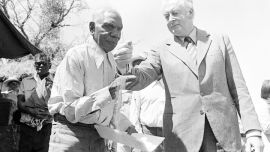 Gough Whitlam formally hands back land to the Gurindji people, pouring soil into the hands of elder Vince Lingiari.