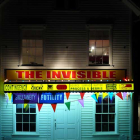 Ester Partegàs, The Invisible, 2008, aluminum and Plexiglas awning, bulbs, fluorescent lights, vinyl, banners, pennants, 20  x 14 x 2 ft. (609.6 x 426.7 x 73.7 cm.,) EP_FP1623, installation at The Aldrich Museum of Contemporary Art, Ridgefield, NY