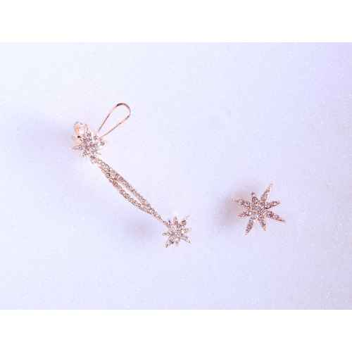 Asymmetrical Faux diamond Star Ear clip earrings.