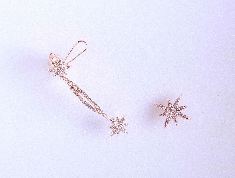 Asymmetrical Faux diamond Star Ear clip earrings.