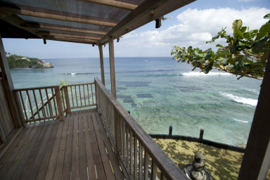 Wooden Cliff Bungalow with balcony overlooking magnificent ocean views