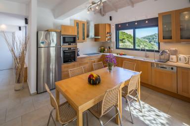 Open kitchen with beautiful window overlooking the harbor of Sivota
