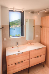 Enjoy the privacy of master bathroom with charming sea view