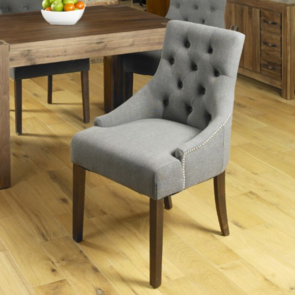 Two grey linen dining chairs with arms