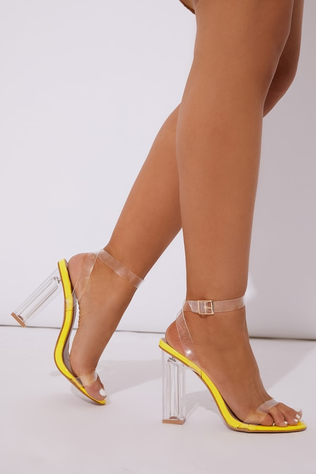 MILINDIA NEON YELLOW CLEAR STRAP BLOCK HEELS