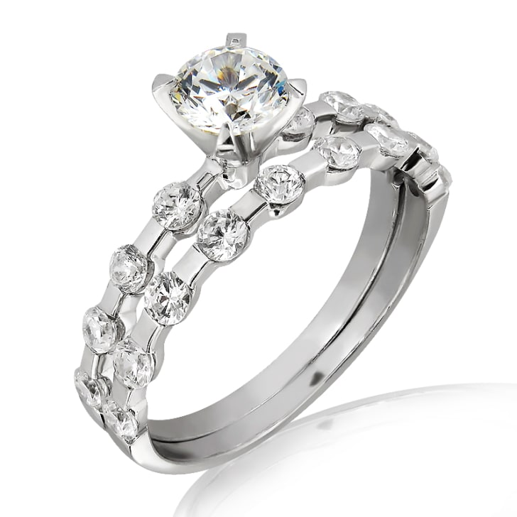 แหวนทอง 18K ประดับเพชร น้ำหนักรวม 0.70 กะรัต ค่าสี F ค่าความสะอาด VS2 เพชรมาพร้อมใบรับรองจาก GIA และมาพร้อมกับ Matching Band