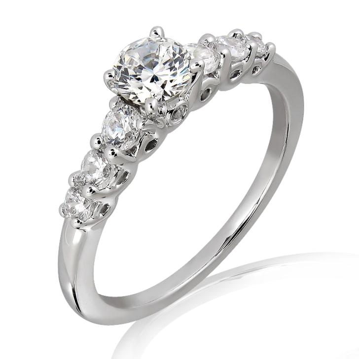 แหวนทอง 18K ประดับเพชร น้ำหนักรวม 0.32 กะรัต ค่าสี E ค่าความสะอาด VS2