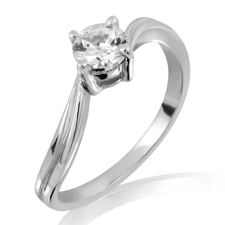 แหวนทอง 18K ประดับเพชร น้ำหนักรวม 0.25 กะรัต ค่าสี H ค่าความสะอาด VVS2