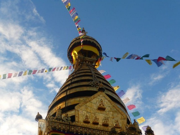 Buddhist prayer flags fluttering atop a temple