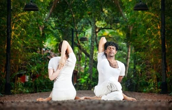 couple doing yoga in India