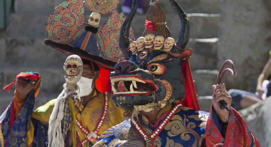 Enchanting Travels Tibet Tours Tibet Buddhist lama ritual mask Cham Dance Tibetan monastery Himalayas