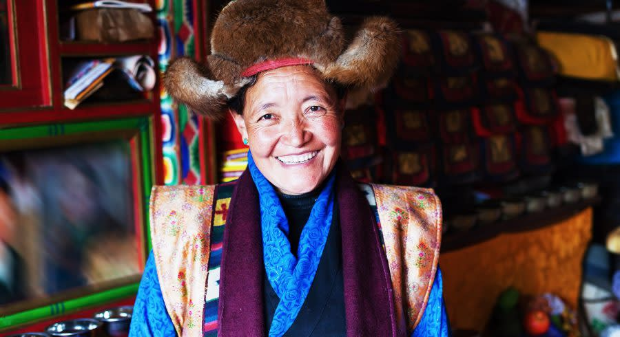 Happy, senior woman from Tibet Tours Asia Enchanting Travels