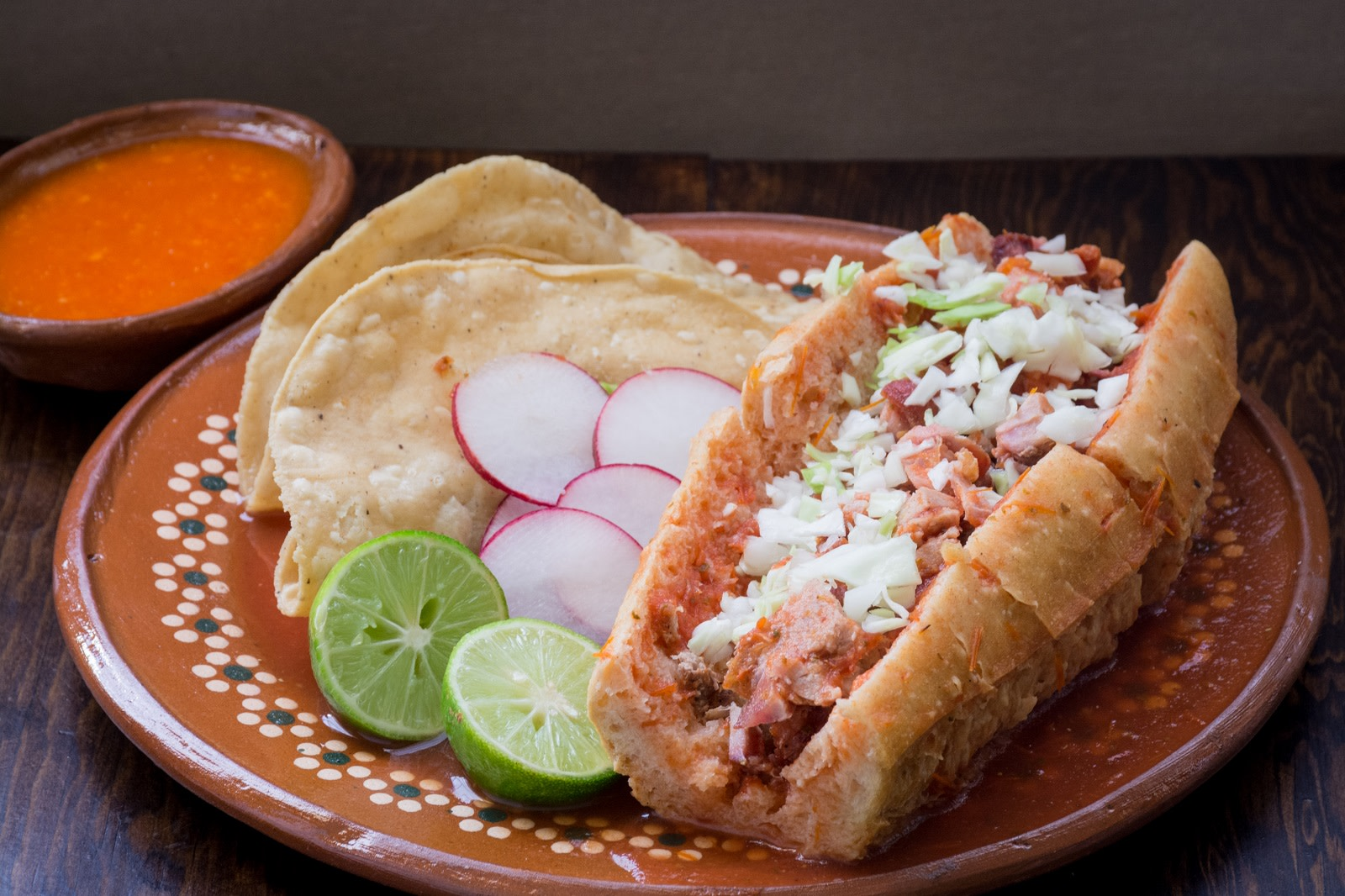 Tortas - A bun stuffed with meat and vegetables and topped with shredded cabbage, cheese, and sour cream. - makes it to our Top 10 food destinations