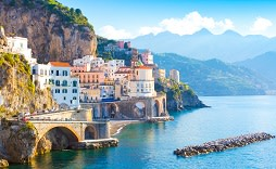 Enchanting Travels Italy Tours Morning view of Amalfi cityscape on coast line of mediterranean sea, Italy