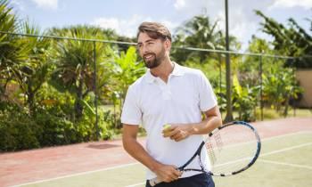 a man holding a racket on a court