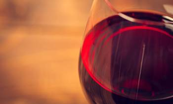 a close up of a glass of red wine