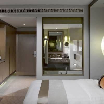 a hotel room with a bed and a mirror