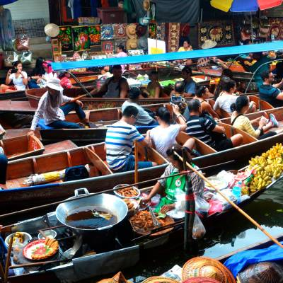 a group of people sitting at a produce market