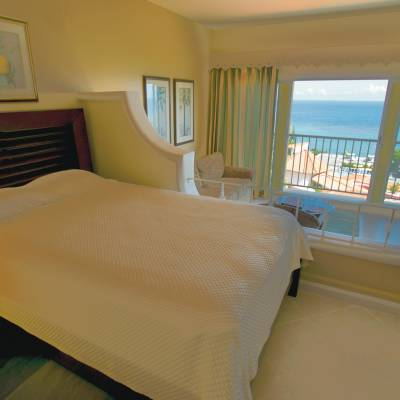 a hotel room with a bed and a window