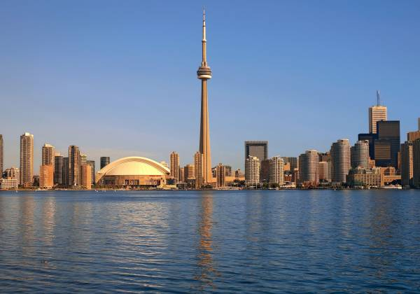 a large body of water with CN Tower in the background