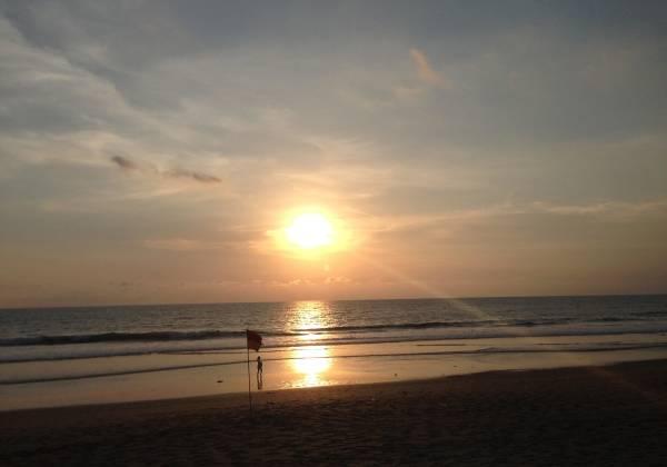a sunset over a beach