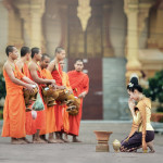 Asia travel deals: Alms-giving - Culture of Laos