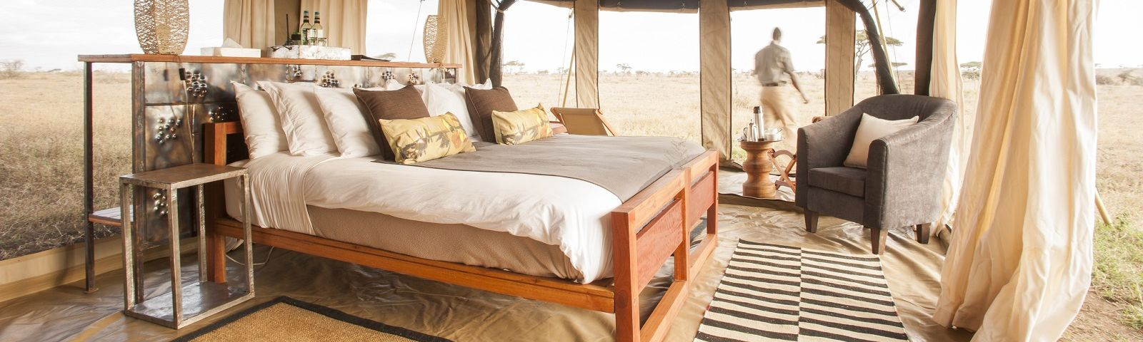 Enchanting Travels - Tanzania Tours - Serengeti (Central) Hotel - Namiri Plains - Guest Bedroom with Staff