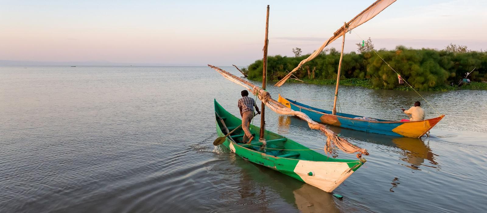 Enchanting Travels Uganda Tours Bulago Island Lake victoria fishermen go to work - culture of Uganda