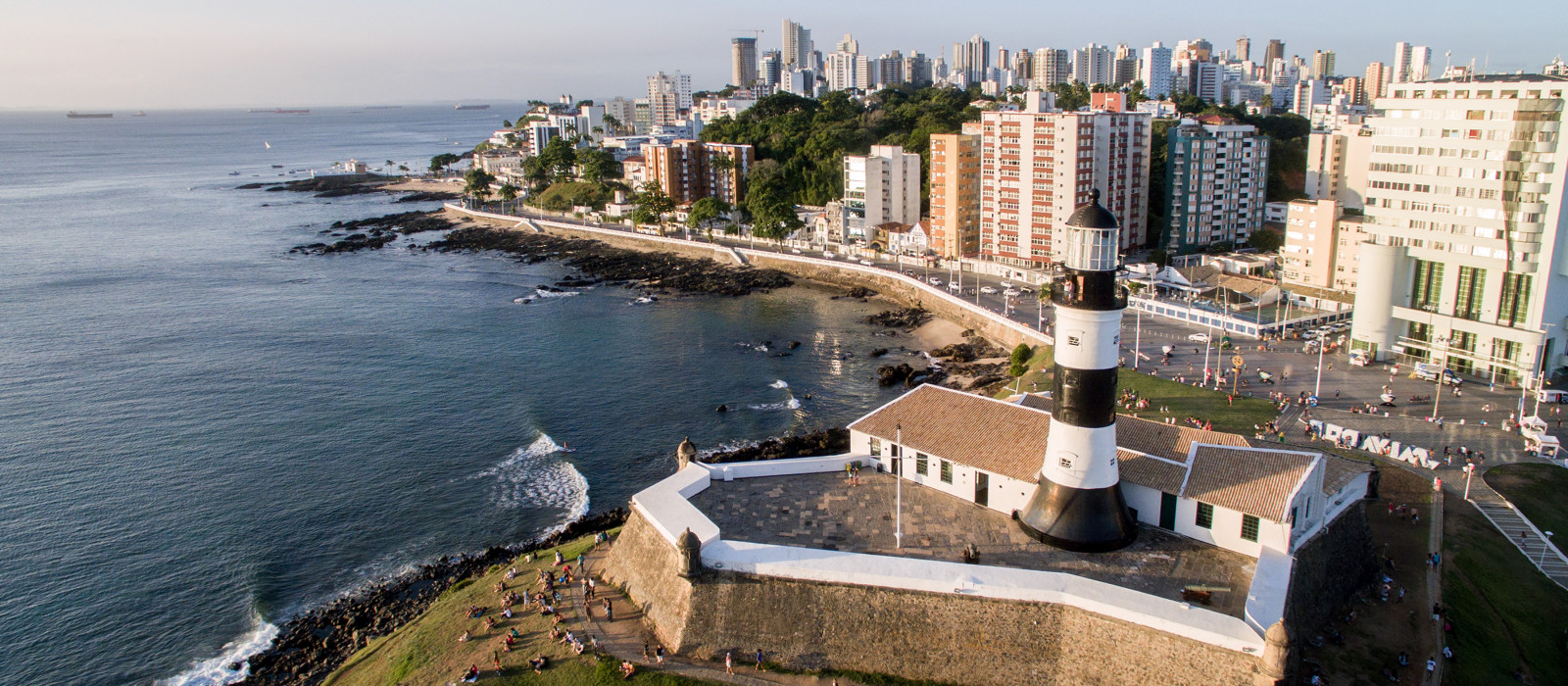 Aerial view of Barra Lighthouse and Salvador cityscape, Bahia, Brazil, South America