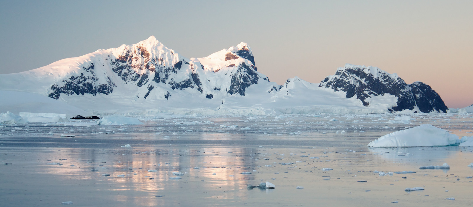 Sunrise over antarctic peninsula - Things to do in Antarctica