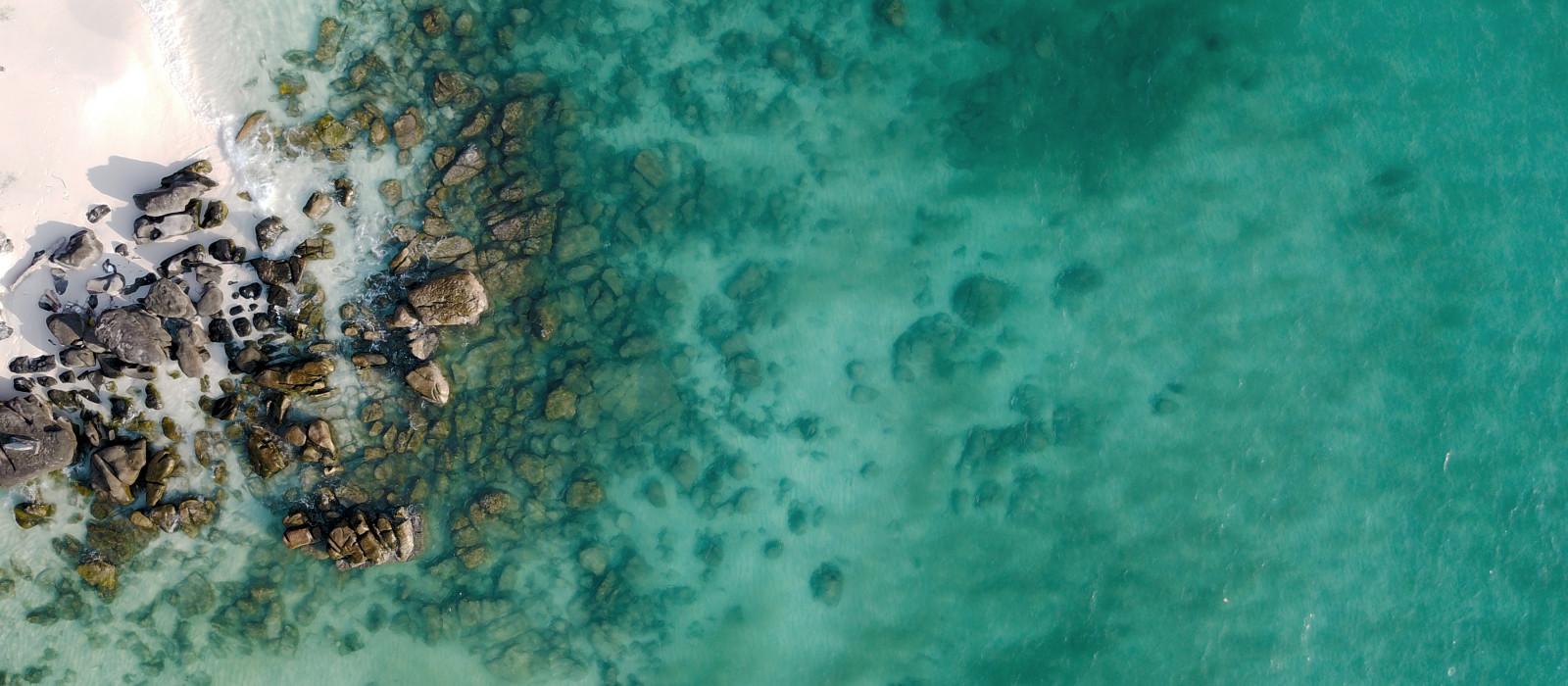 Aerial top view of Long Beach coast in Koh Rong, Cambodia, Asia