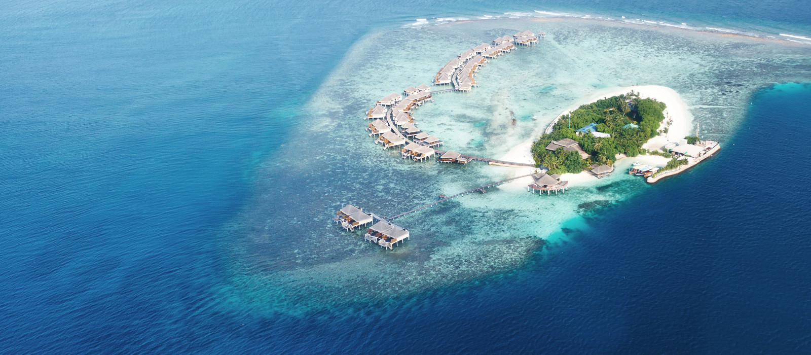 Group of atolls and islands in Maldives from aerial view, Asia
