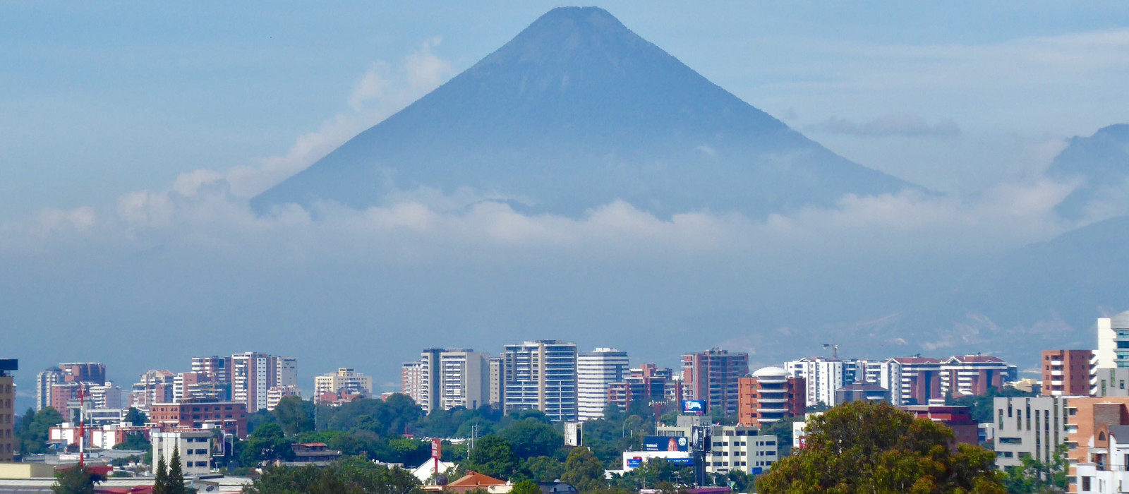 A low cloud base covers part of Fuego volcano in Guatemala City, capital of Guatemala