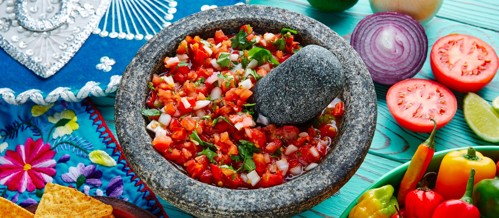 Mexican cuisine Pico de Gallo sauce from Mexico with tomato cilantro and onion in molcajete