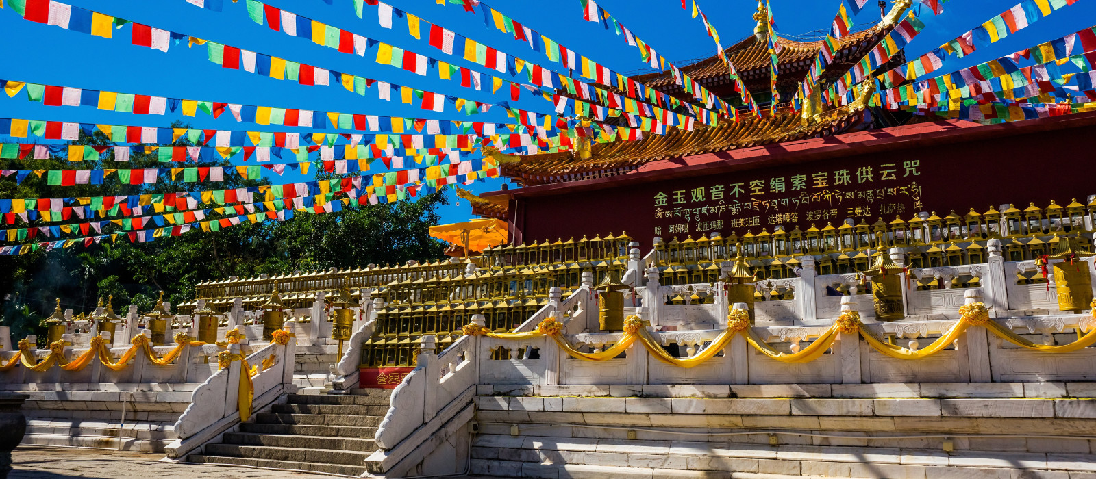 Enchanting Travels China Tours Chinese temple in China with colorful prayer flags - culture of China