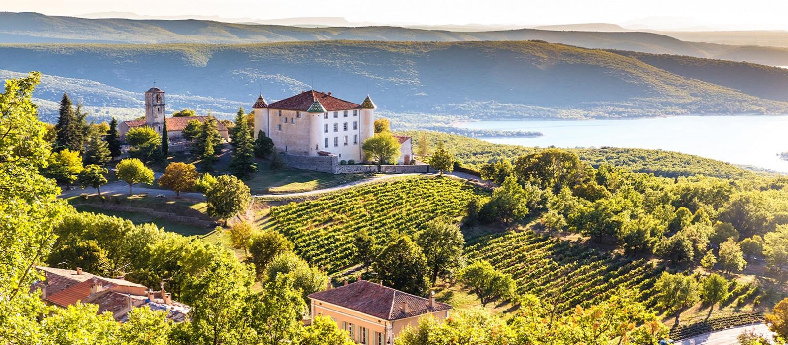 View Of Aiguines Village And Renaissance-style Chateau Overlooking Lac de Sainte Croix Lake-Alpes de Haute Provence, France