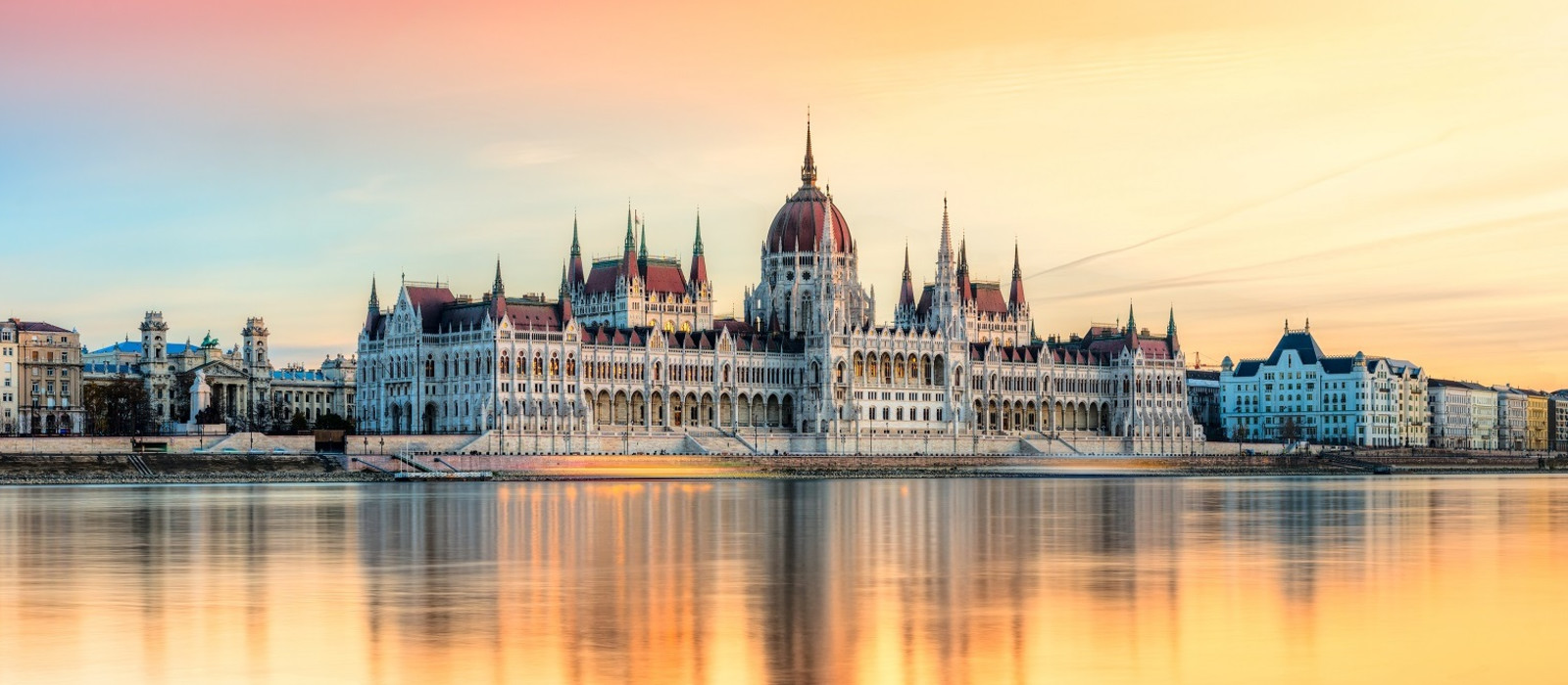 Enchanting Travels European Capitals ToursView of Budapest parliament at sunset, Hungary European Cities tours