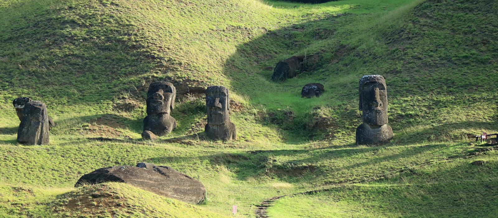 Hundreds of abandoned Moai statue on Rano Raraku volcano, Easter Island, Archaeological UNESCO World Heritage site of Chile, South America