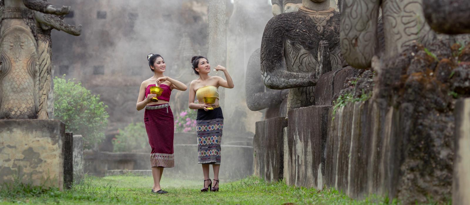 Beautiful Lao woman splashing water during Songkran Festival, Lao Vientiane Tradition, Asia - Laos travel guide