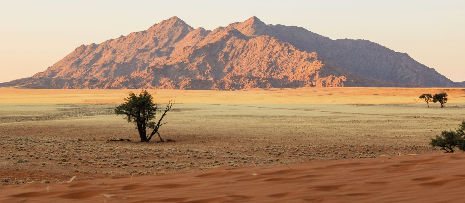 Red sand dunes and granite outcrops in Sesriem, Namibia, Africa
