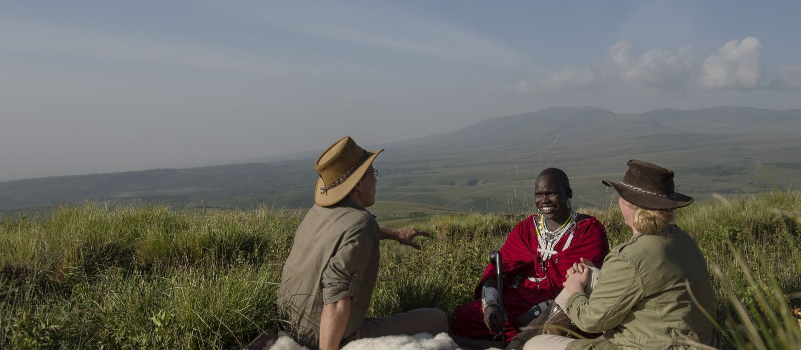 Highlands-Ngorongoro-guests-maasai-guide-picnic-Eliza-Deacon-2-HR