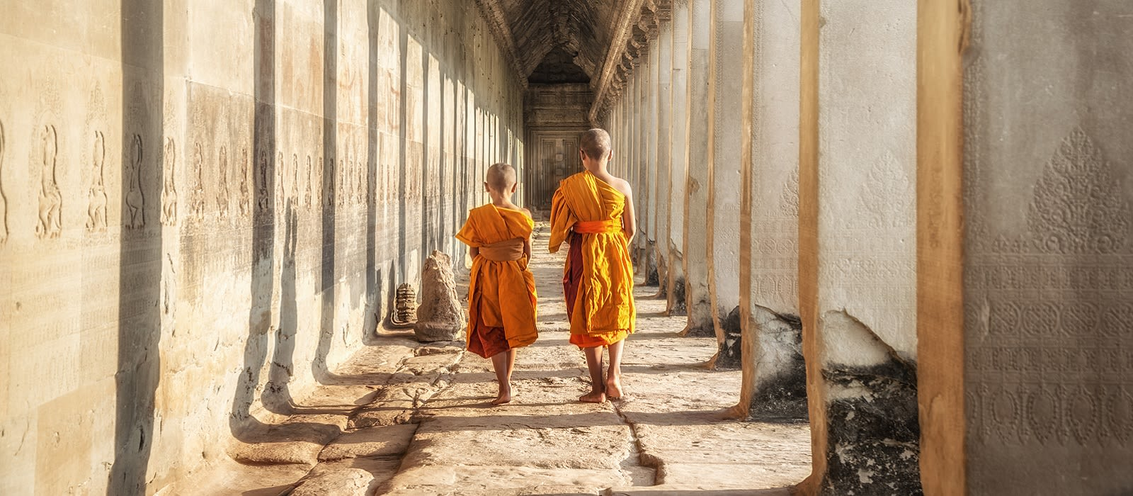 Enchanting Travels Cambodia Tours Two neophytes walking in an Angkor Wat, Siem Reap, Cambodia Vacation