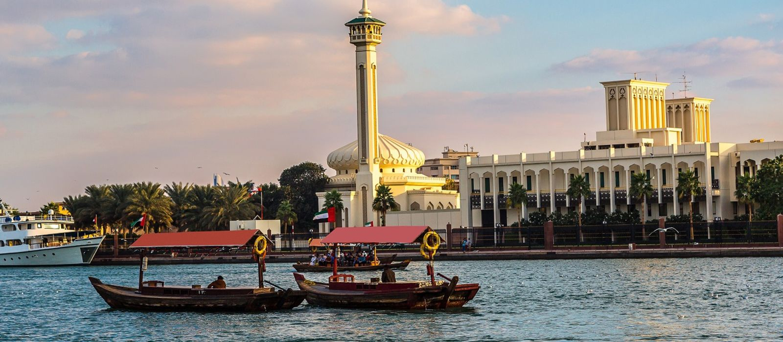 Enchanting Travels UAE Tours Old traditional boats on the bay Creek in Dubai - Best time to visit UAE