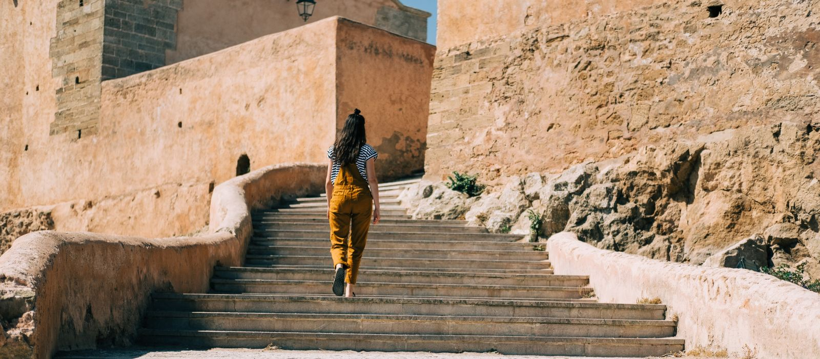 Girl explores ancient walled fortress known as the Kasbah des Oudayas in Morocco