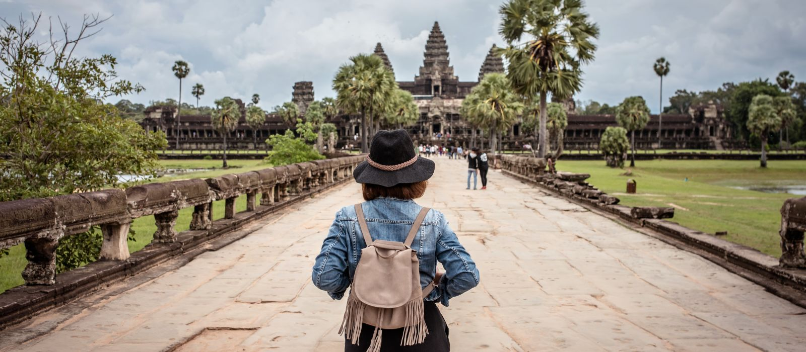 Women tourists wear jacket jeans walking into Angkor Wat landmark in Siem Reap, Cambodia, Asia