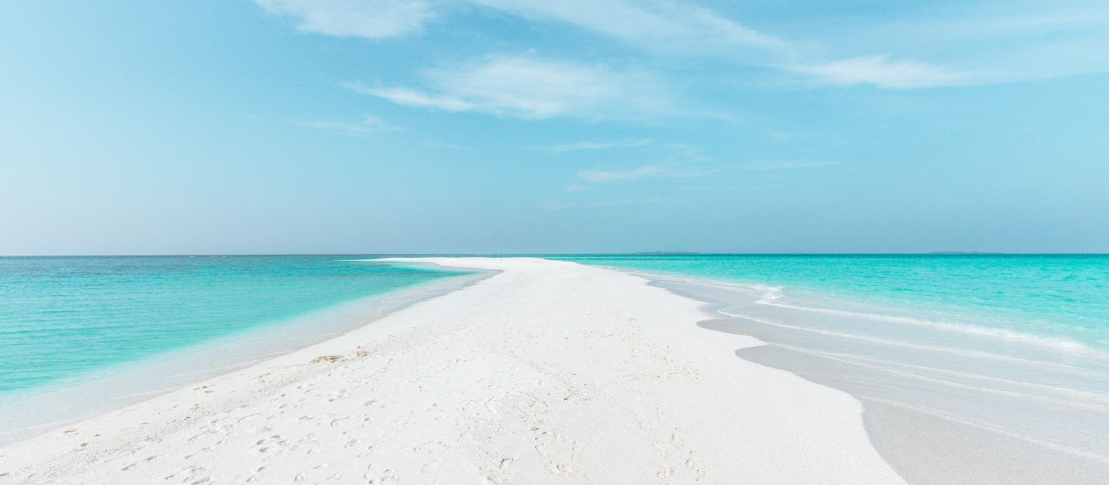 Sandbank in Maldives with crystal clear beautiful water and white sand