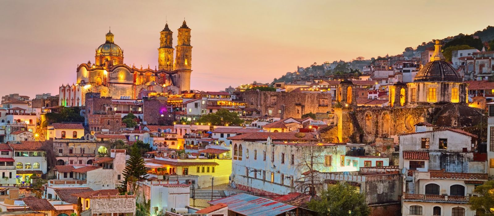 Panorama of Taxco city at sunset in Mexico - Mexico travel guide