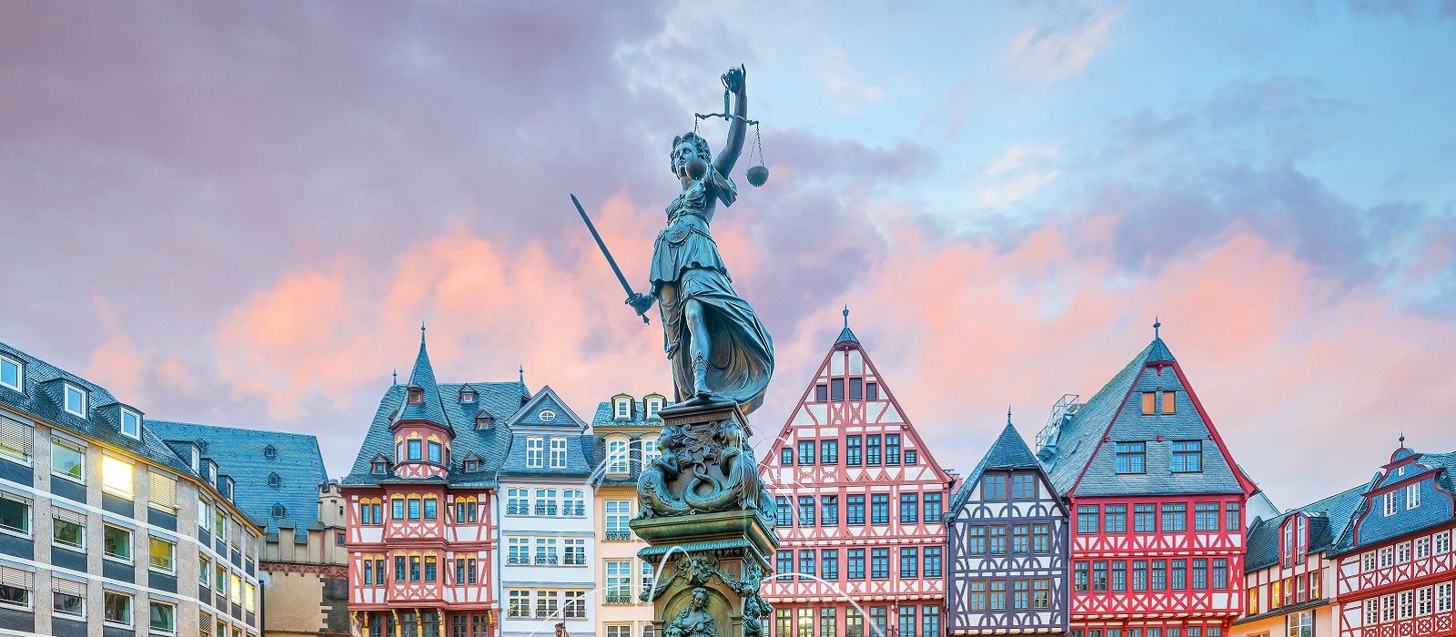 Enchanting Travels Germany Tours Old town square romerberg in Frankfurt, Germany at twilight